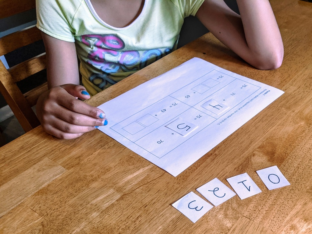 Girl thinking as she solves a Number Puzzle