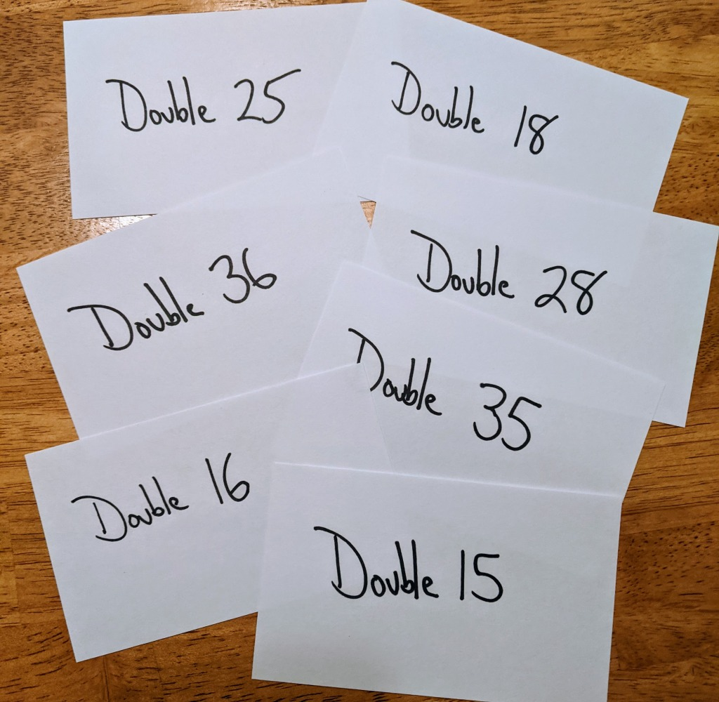"""Set of flashcards that say things like """"Double 25"""" and """"Double 18"""""""