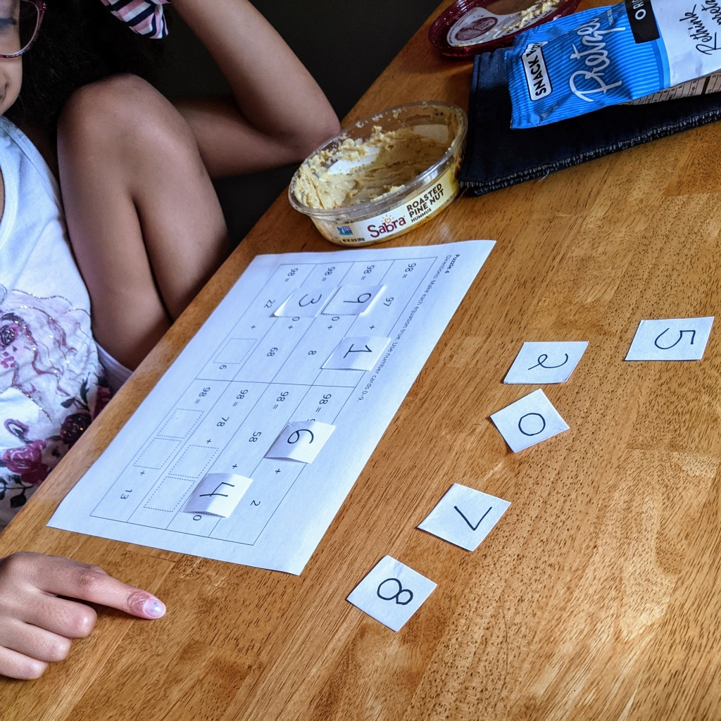 Girl thinking as she solves a Number Puzzle that includes even more equation